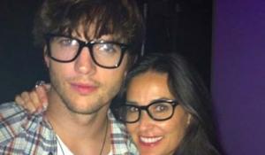 Demi Moore eta Ashton Kutcher betaurrekoak jantzita